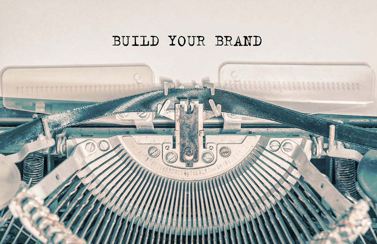 BUILD YOUR BRAND typed words on a vintage typewriter